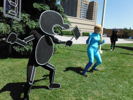 Mr.Game and watch VS. Zero Suit Samus cosplay by DragonFly188