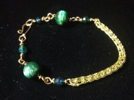 Green and gold bracelet by Taffy-art