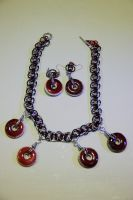 Red stone disks on Helms chain and earrings by Luherc
