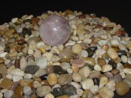 Rose quartz on stones by othertalk