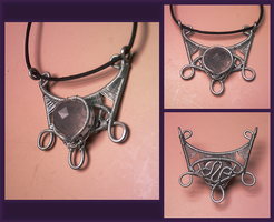 Amethyst Shield Necklace by razzigyrl