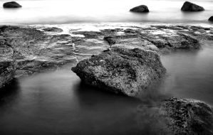 rock in water by Dune-sea
