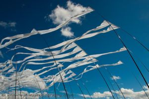 Flags and blue sky by johnleewheatley
