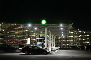 Gas station at night by ArtOfPedL