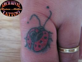 lady bug on big toe by theothertattooguy