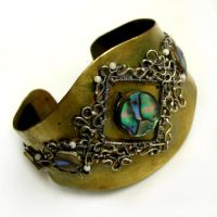 Paua shell on brass by TriquetraZone