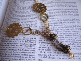 Steampunk vial necklace by Hiddendemon-666