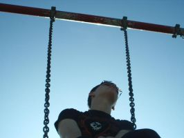 Emo kid on a swing by sauerkraus