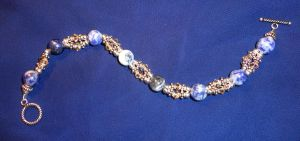 Champagne and Blue Bracelet by RaCzarina