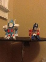 Armored ultra magnus and optimus prime by Lilscotty