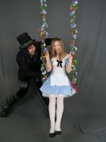 Alice and Hatter on swing 2 by MajesticStock
