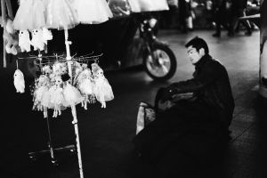 Some dolls and a vendor in the night market by CHAOKUNWANG