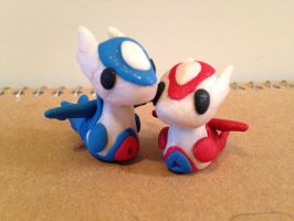 Latios and Latias clay figures by fluffscarf