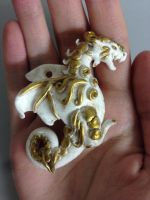 White-bronze dragon pendant by BlueIrisFlower
