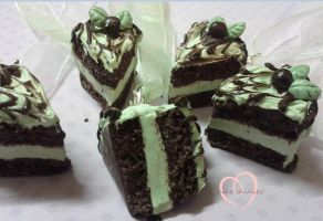 Choc-mint cake slice necklaces close up by ilikeshiniesfakery