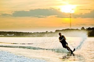 Water sports at sunset by Thoesoe