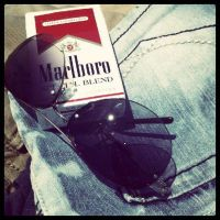 cigarettes and sunglasses by poeticwriter007