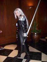 Sephiroth with sword by scattersakurablossom