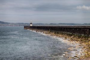 At the end of Breakwater by CharmingPhotography