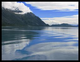 Reflection of cloud and sky by Roland3791