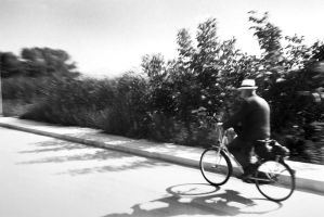 Old man bicycling by Nosfist