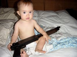 baby with a shotgun by klung1