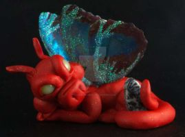 Red Laying Down Pixie Dragon by The-GoblinQueen