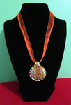 Orange Art Deco Ribbon Necklace by BloodRed-Orchid