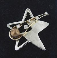 Golden Shooting Star by GipsonDiamondJeweler