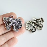 Quetzalcoatl Charms by MonsterBrandCrafts