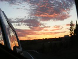 rierview mirror sunset 2 by BlueIvyViolet