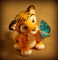 Little tiger and butterfly by melinaminotti