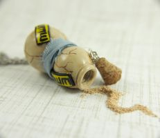 Gaara's Gourd necklace by TrenoNights