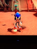 Sonic on a rock in sonic unleashed by AskTuxSonicsSister