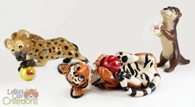 Hyena, Tiger and Otter with Marbles by LeiliaClay