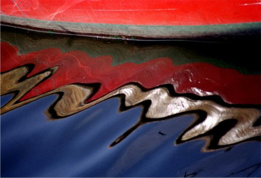 rowboat and reflection by berkerr