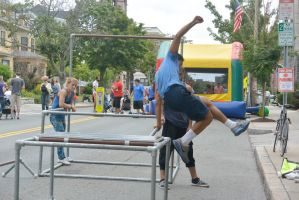 Summer Days Street Fair, Braving the Pole Jumping  by Miss-Tbones