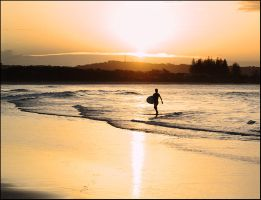Surfer and golden sunset by wildplaces