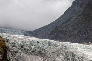 NZ Glacier with mountain edge fading to fog by Chunga-Stock
