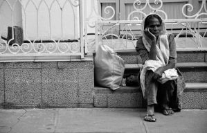 Old lady in front of the mosque. by Gothumanity