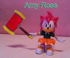 Amy Rose and her hammer by Shadowsgirl1221