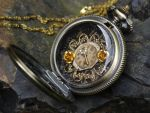 Steampunk golden locket by Hiddendemon-666