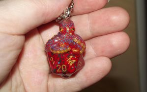 Red and Gold blue-spotted Octopus D20 pendant by ShadyDarkGirl