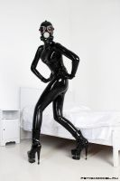 Black Latex Rubber Girl in a White Room. 6 by agnadeviphotographer