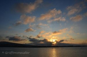 Sun over Orkney by griffonmeister