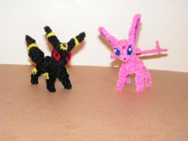Umbreon and Espeon by fuzzyfigureguy