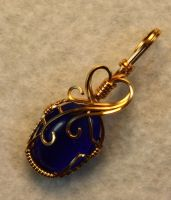 Blue Catseye Pendant by skezzcrom