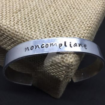 Noncompliant stamped bracelet by theevergreenburrow