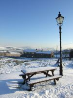 Bench And Lampost in the snow. by Marroon