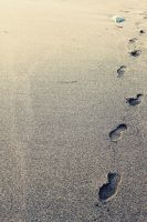 Footprints on the sand by fuzzy-blue-light